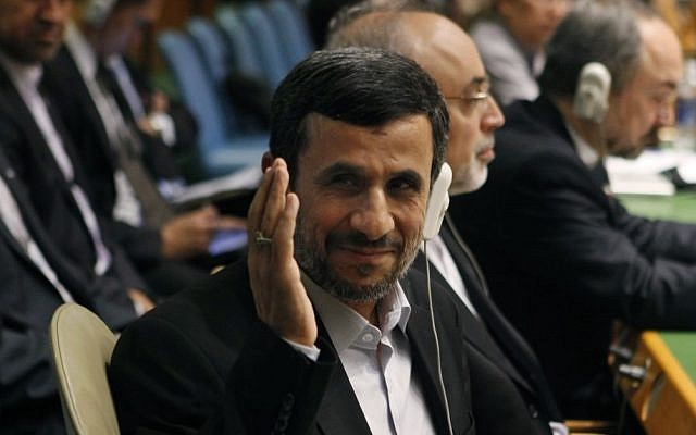Iranian President Mahmoud Ahmadinejad gestures as he arrives at his seat before addressing the UN General Assembly on Wednesday (photo credit: AP/Jason DeCrow)