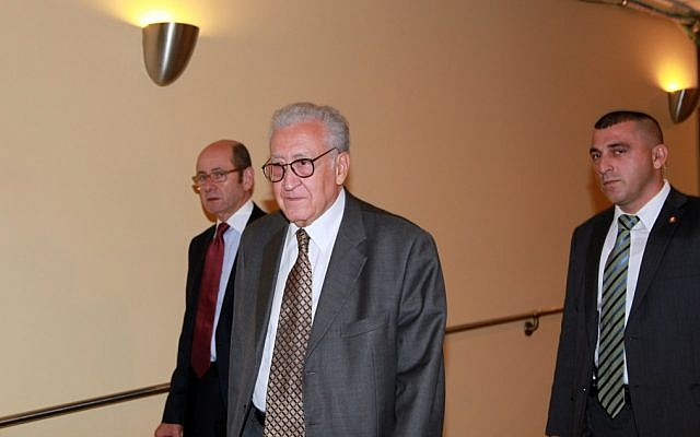 Lakhdar Brahimi, center, joint special representative for Syria, arrives at closed door consultations regarding the situation in Syria at the Security Council at United Nations headquarters Monday, Sept. 24 (photo credit: AP/David Karp)