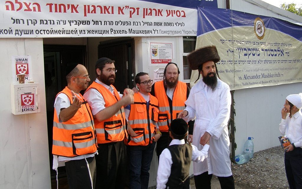 Four paramedics welcome a patient at the entrance of the Uman Emergency Clinic near the start of Rosh Hashanah. (Cnaan Liphshitz/JTA)
