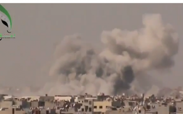 Smoke rising from a bombing in Damascus on September 19. (photo credit: Image capture from YouTube video uploaded by Freeeeelibyan)