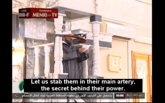 A Benghazi preacher calling for a violent boycott of the West because of its irreverence towards the Prophet Mohammed. (photo credit: Image capture from MEMRITV video)