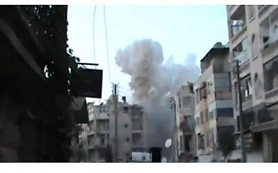 Syrian air force bombs an Aleppo neighborhood on Thursday, August 30. (photo credit: Image capture from YouTube video uploaded by SpaceIraneesKiller)