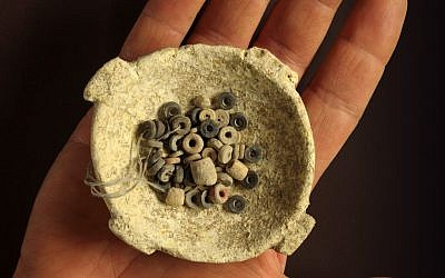 A bowl with stone beads dates to an ancient culture that flourished in modern-day Israel 7,000 years ago (photo credit: Courtesy of the Israel Antiquities Authority/Clara Amit)