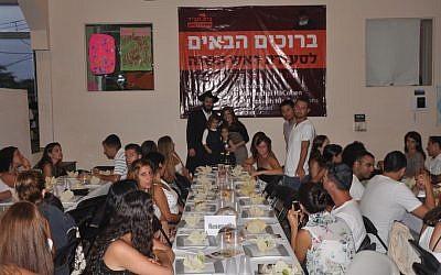 Guests at the Chabad Rosh Hashanah meal in Playa, Mexico, with Rabbi Mendel and wife Chaya at back (photo credit: Chabad, Playa del Carmen)