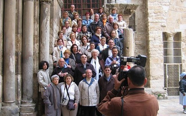 Tourists at the Church of the Holy Sepulcher (photo credit: Shmuel Bar-Am)
