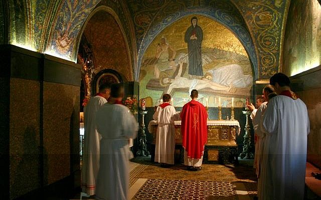 Latin mass at the 11th Station of the Cross at the Church of the Holy Sepulcher (photo credit: Shmuel Bar-Am)