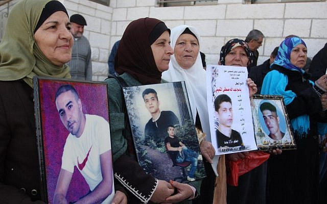 Palestinians holding pictures of their jailed sons in 2011. (photo credit: Issam Rimawi/Flash90)