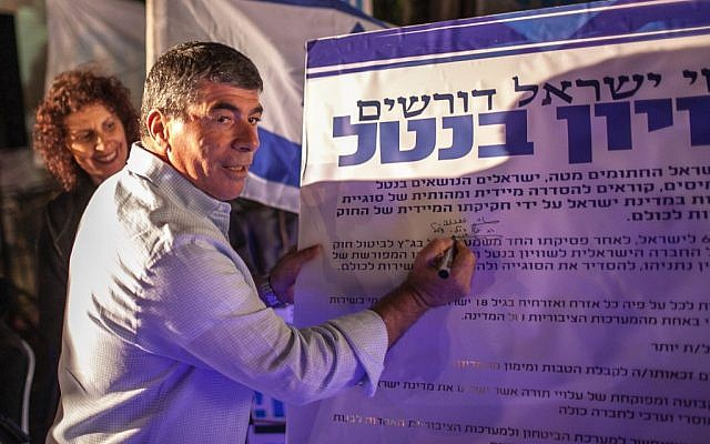 Is that document real? The final draft regarding the Harpaz Affair is almost complete.  Here former IDF Chief Gabi Ashkenazi signs his name for universal service.  (photo: Noam Moskowitz/FLASh90)