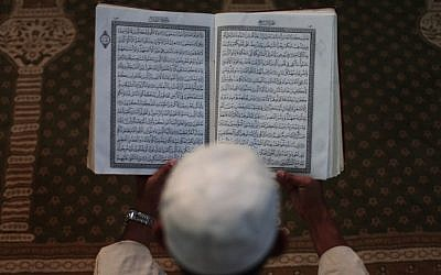 A Palestinian Muslim reads the Holy Quran at the Al-Omari mosque in the Gaza Strip. (photo credit: Wissam Nassar/Flash90)