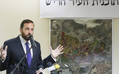 Ariel Atias,former minister of Housing and Construction, lays out the plans for the new ultra-Orthodox city of Harish in northern Israel in August  2012. (photo credit: Oren Nahshon/Flash90)