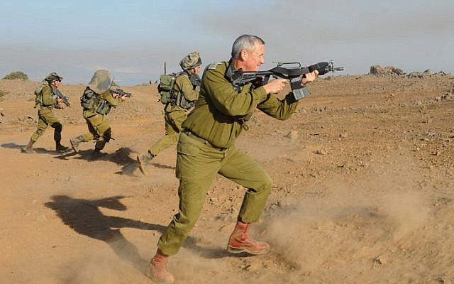 Chief of Staff Lt. Gen. Benny Gantz in action during a live fire exercise for battalion commanders on the Golan Heights, September 4, 2012. (photo credit: Shay Wagner/IDF/Flash90)