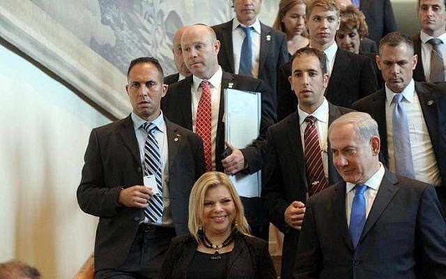 Prime Minister Benjamin Netanyahu and his wife Sara lead the Israeli delegation out of the UN headquarters in New York, NY on Thursday Sept. 27 (photo credit: Avi Ohayon/GPO/Flash90)