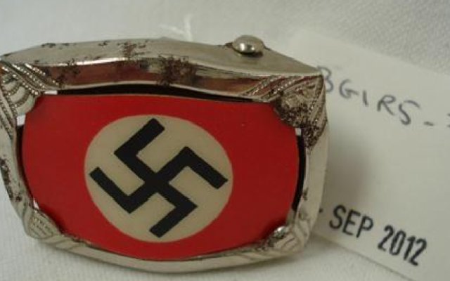 A swastika buckle, Hitler youth armbands and other Nazi