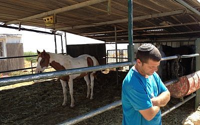 Itay Harel outside of his horse stables in Migron (Photo credit: Mitch Ginsburg/ Times of Israel)
