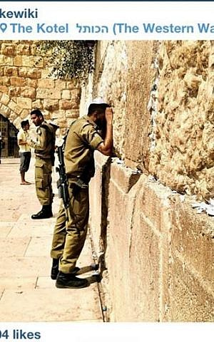 A soldier praying at the Western Wall photographed by Istagrammer kewiki (photo credit: courtesy of Stand With Us)