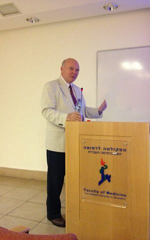 Genocide Watch founder and director Greg Stanton delivering a lecture at the Hebrew University's medical school (Photo credit: Mitch Ginsburg/ Times of Israel)