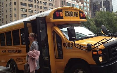 A German reporter exists the school bus that brought her to the UN (photo credit: Raphael Ahren/Times of Israel)
