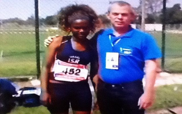 Tigist Bito, 15, with her coach. (photo credit: Image capture from Channel 2)