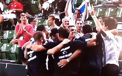 Amir Weintraub (right in white) celebrates victory with the rest of the Israeli Davis Cup team in Tokyo on Friday (photo credit: Sports5 screenshot)