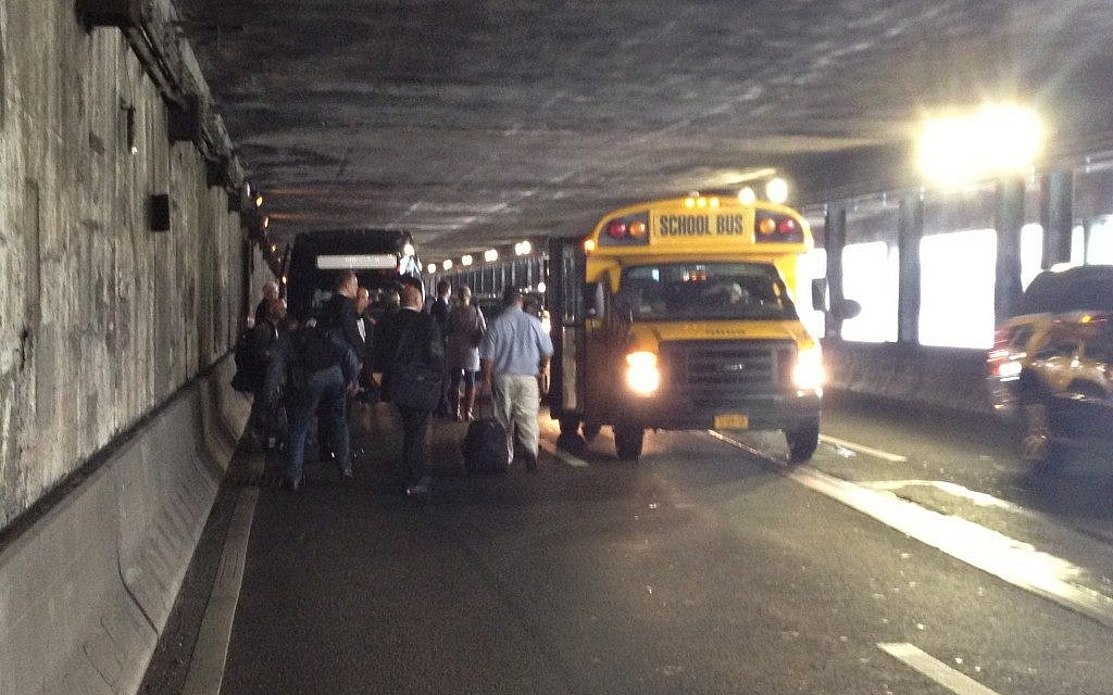 Israeli journalists stranded on FDR Drive, about to board a school bus to take them to the UN (photo credit: Raphael Ahren/Times of Israel)