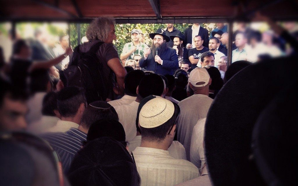 Rabbi Yoshiyahu Pinto leads the pilgrimage to the gravesite, in September (photo credit: Times of Israel/Matti Friedman via Instagram)