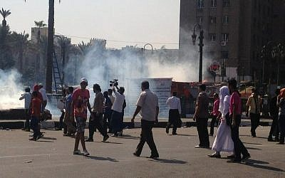 Tear gas wafting through Tahrir Square as police clash in protesters in Cairo Thursday morning. (photo credit: Sherine Tadros via Twitter)