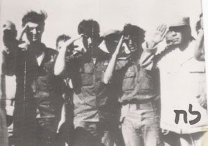 Ehrenfeld, middle, and the Egyptian colonel, left, saluting the Egyptian flag (Photo credit: Courtesy: Erim Balaila)