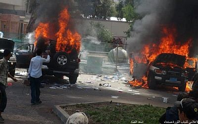 Cars burning from inside the US Embassy compound in Sanaa in September 2012. (photo credit: Haykal Bafana via Twitter)