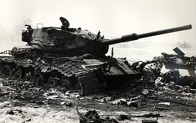 A wrecked Israeli tank during the early days of the Yom Kippur War (Wikimedia Commons)