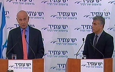 Yaakov Peri (left) and Yair Lapid at a Yesh Atid party press conference on Tuesday. (photo credit: image capture from Channel 2)