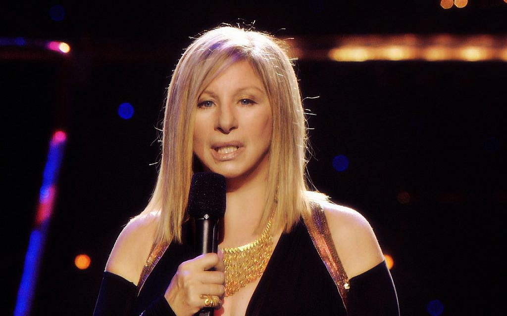 "Barbra Streisand will sing ""I'll Be Home for Christmas"" with John Travolta and Olivia Newton-John. (Photo credit: CC BY/JCT(Loves)Streisand via Flickr.com)"
