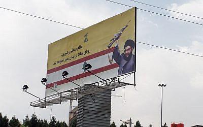 A billboard showing Hezbollah chief Hassan Nasrallah purportedly in Tehran. (photo credit:  CC BY-SA Giorgio Montersino, Flickr)