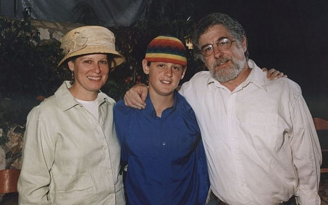 Seth and Sherri Mandell with Koby (center) months before his death (Courtesy the Mandell family)