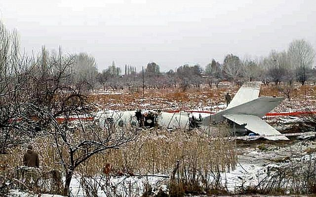 An Iranian military passenger jet which crashed near Tehran in 2009. A newly leaked US report described air defense mishaps in the country in 2007 and 2008 (photo credit: AP)