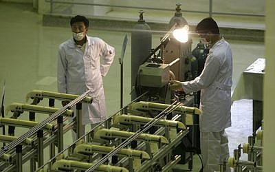 Iranian technicians working at a facility producing uranium fuel for a planned heavy water nuclear reactor, outside Isfahan, in 2009. (AP/Vahid Salemi)