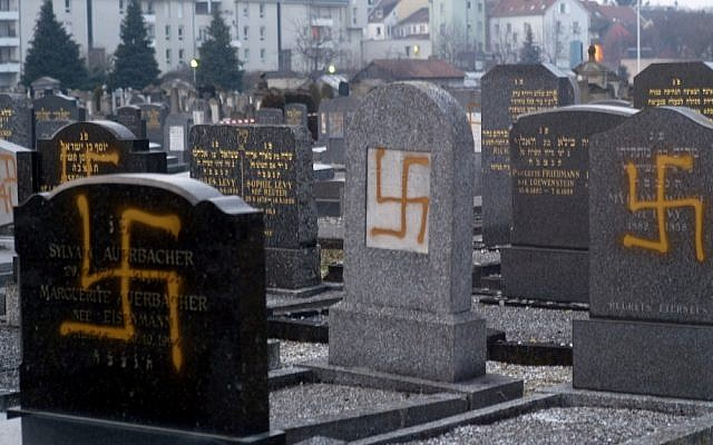Illustrative photo of desecrated graves in the main Jewish cemetery of Strasbourg, France, in 2010 (photo credit: AP/Christian Lutz)