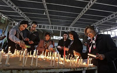 Iranian Jews light candles as they pray at the shrine of biblical prophet Daniel, in the city of Susa, some 450 miles (750 kilometers) southwest of the capital Tehran, February 2012 (photo credit: AP/Vahid Salemi)