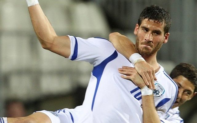 Israel's Tomer Hemed (foreground) and fellow team member Maor Melikson celebrate after Hemed scored a goal during their World Cup Group F qualifying soccer match at the Josy Barthel stadium in Luxembourg, Friday, October 12 (photo credit: AP/Yves Logghe)