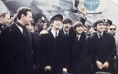 Brian Epstein (left) with The Beatles on tour in 1964. (AP Photo)
