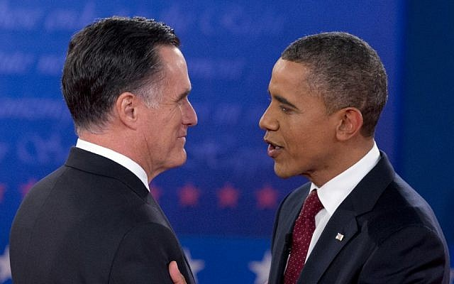 US President Barack Obama and Republican presidential candidate, former Massachusetts Gov. Mitt Romney, greet each other as they arrive for the presidential debate, Tuesday, Oct. 16, 2012, at Hofstra University in Hempstead, N.Y. (photo credit: Carolyn Kaster/AP)