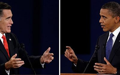 President Barack Obama, right, and Republican presidential nominee Mitt Romney speak during the first presidential debate at the University of Denver, Wednesday, Oct. 3, 2012, in Denver. (photo credit: Charlie Neibergall/AP)