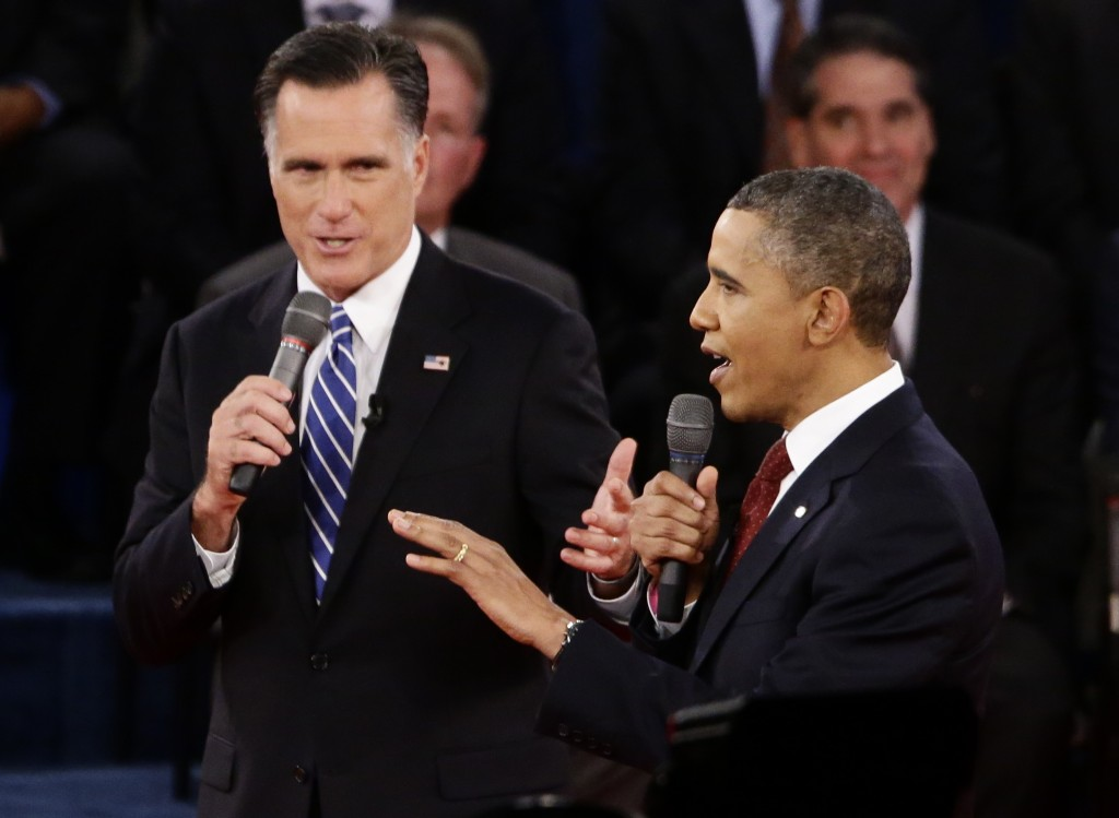 US President Barack Obama and Republican presidential candidate and former  Massachusetts governor Mitt Romney speak during
