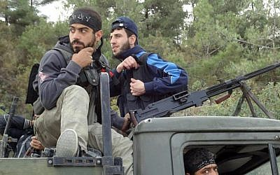Free Syrian Army rebels capture an army truck at the village of Khirbet Al-Jouz, near Idlib, October 7 (photo credit: AP)