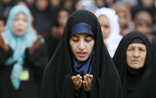 Iraqi Shiite women attend Eid al-Adha prayers in Baghdad last year (photo credit: AP/Hadi Mizban)