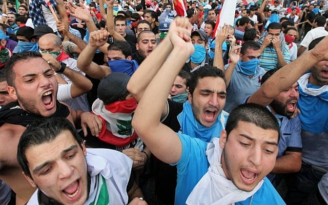 Lebanese protesters chant slogans against the Lebanese government after the funeral of Brig. Gen. Wissam al-Hassan on Sunday (photo credit: AP/Bilal Hussein)