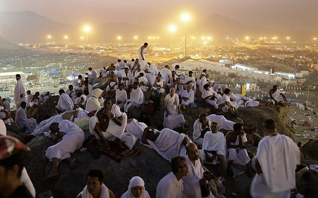 Muslim pilgrims pray on a rocky hill called the Mountain of Mercy, on the Plain of Arafat near the holy city of Mecca, Saudi Arabia, in the early hours of Thursday, Oct. 25, 2012. (photo credit: Hassan Ammar/AP)