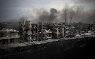 Smoke rises over Saif Al Dawla district in Aleppo, Syria, Tuesday, Oct. 2, 2012. The U.N.'s deputy secretary-general says U.N. chief Ban Ki-moon made a strong appeal to Syria's foreign minister to stop using heavy weapons against civilians and reduce the violence that is killing 100 to 200 people every day. (Manu Brabo/AP)