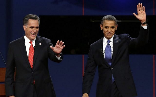 Republican presidential nominee Mitt Romney, left, and US President Barack Obama wave to the audience before the first presidential debate at the University of Denver earlier this month (photo credit: AP/Charlie Neibergall)