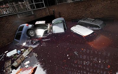 Cars are submerged at the entrance to a parking garage in New York's Financial District in the aftermath of superstorm Sandy, Tuesday, Oct. 30, 2012. (photo credit: Richard Drew/AP)
