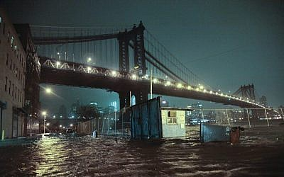 Streets are flooded under the Manhattan Bridge in the Dumbo section of Brooklyn, N.Y., Monday, Oct. 29, 2012. (photo credit: Bebeto Matthews/AP)